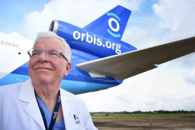 Doctor Lee Alward in front of an Orbis.org airplane
